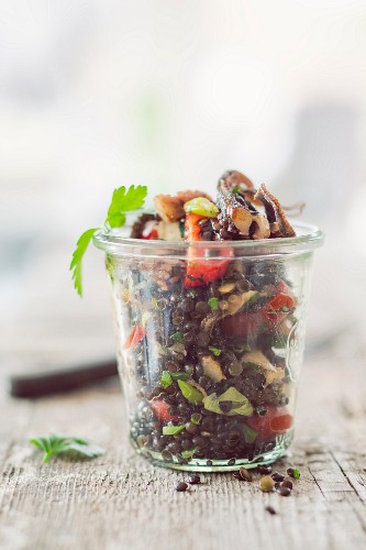 Lentil salad with octopus in a glass jar