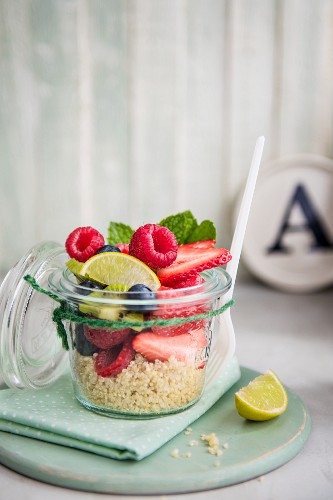 Fruit salad with quinoa in a jar for lunch