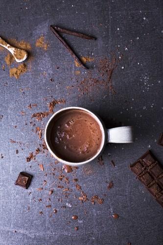 Hot chocolate with block of chocolate, milk cinnamon and sea salt