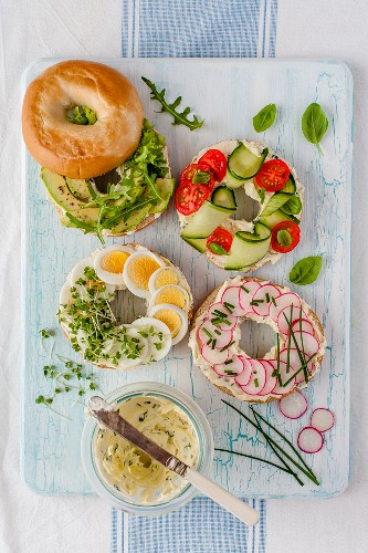 Bagels with chives, fresh cheese and vegetables (top view)