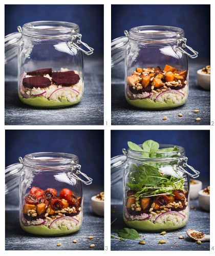 Vegan layered salad in a glass jar with couscous, asparagus, pine seeds and avocado and lime dressing being made