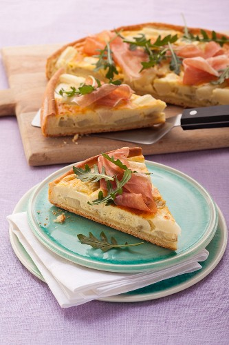 White asparagus quiche with Parma ham and arugula