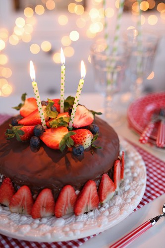 Chocolate cake with strawberries for a birthday