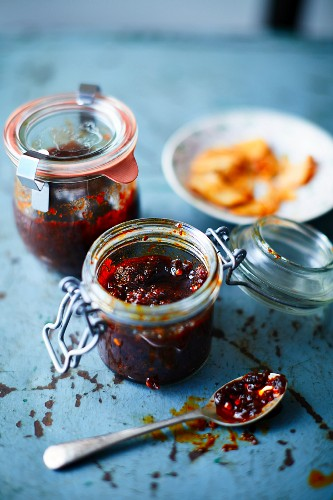 Homemade chilli paste in preserving jars
