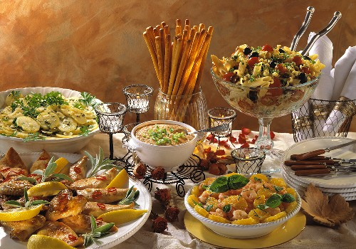 Tuscan New Year's Eve buffet, with salads, chicken, grissini