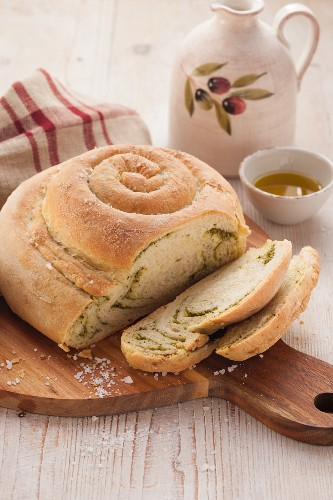 Snail-shaped bread with pesto
