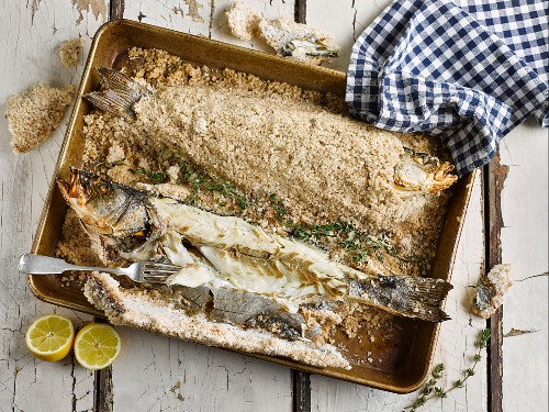 Sea bass, baked in salt