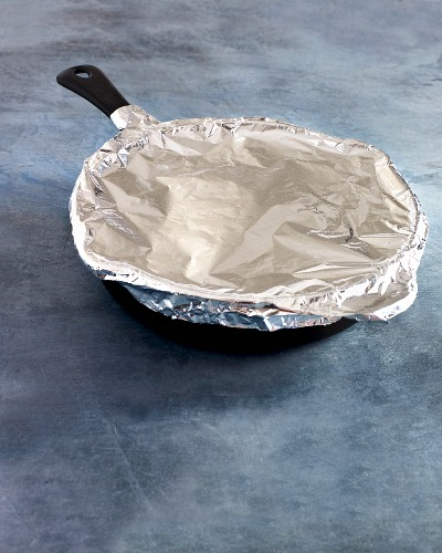 A pan covered with aluminium foil for the oven