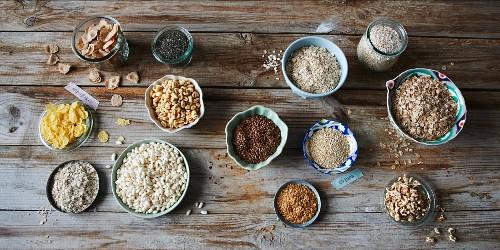 Various muesli ingredients in small bowls