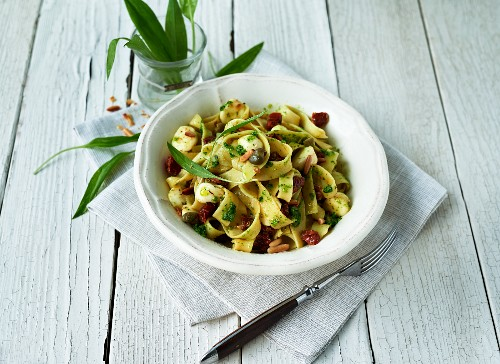 Tagliatelle with wild garlic pesto, dried tomatoes, capers and pine nuts
