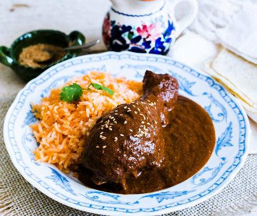 A chicken leg with mole poblano and rice (Mexico)