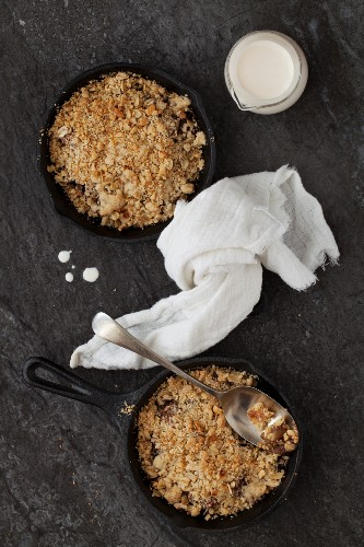 Chocolate and pear crumble in cast iron pans