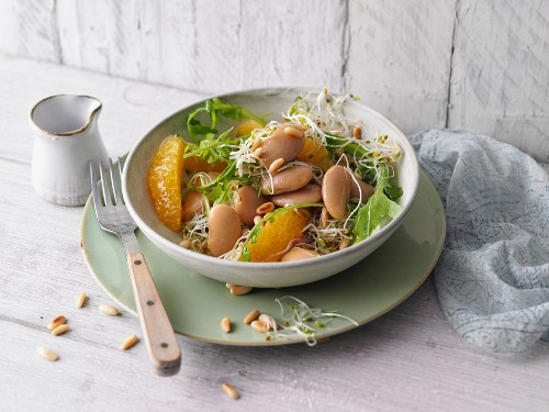 Vegetarian butter bean salad with oranges and shoots