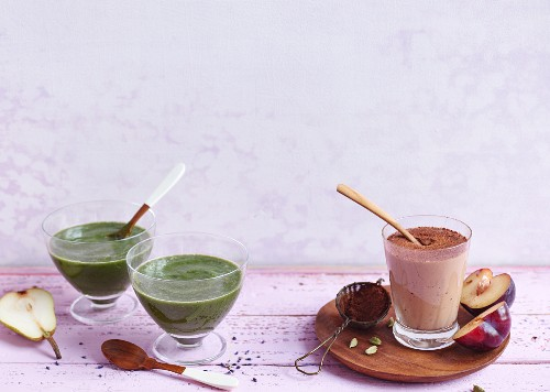A lavender and pear smoothie and a chocolate and plum smoothie