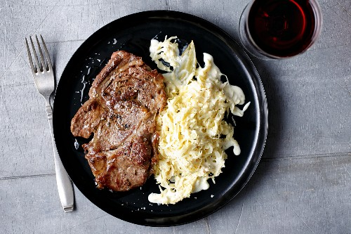 Fried rib-eye steak with creamy sauerkraut