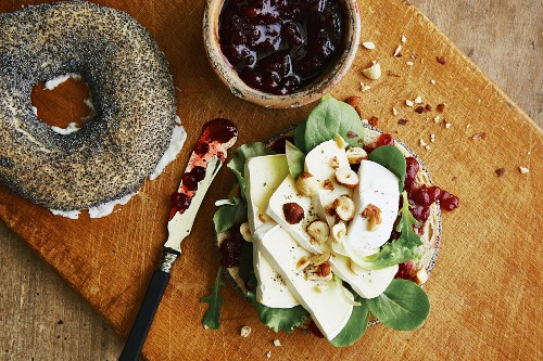 A Camembert bagel with lamb's lettuce and lingonberries