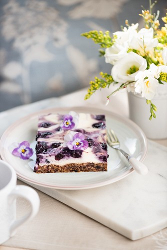A piece of blueberry cheesecake
