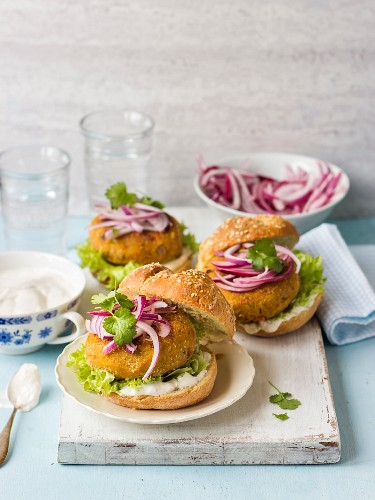 Carrot and chickpea burgers with red onion, coriander and lettuce
