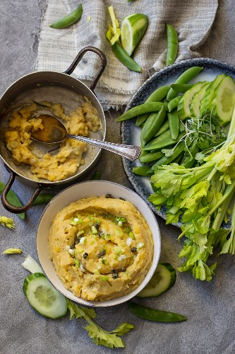 Yellow pea dip with cucumber, sugar snap peas, celery and pea leaves