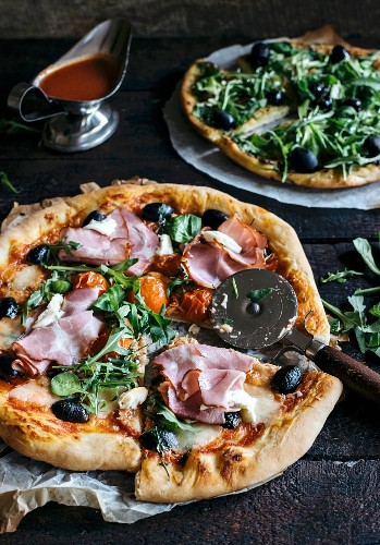 Served and sliced pizza with ham and mozzarella cheese
