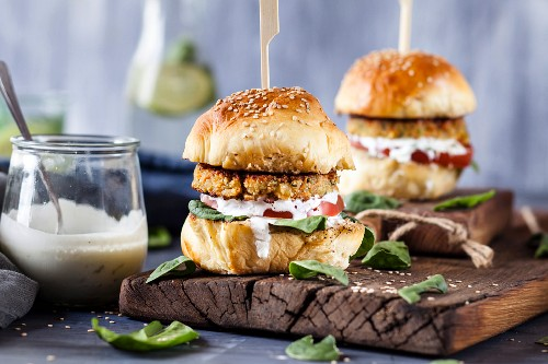 Veggie burgers with vegetable and halloumi patties and tzatziki sauce
