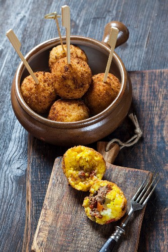 Arancini (fried rice balls filled with mince and mozzarella, Italy)
