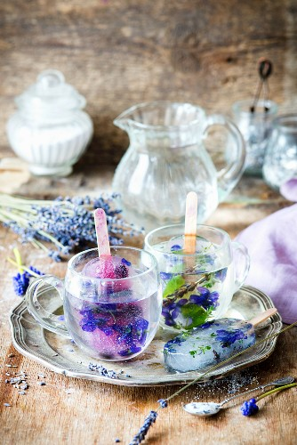 Lavender lemonade ice lollies served in glasses of water