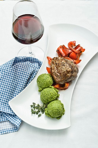 A pink roast beef fillet with thyme infused peppers and broccoli mousse