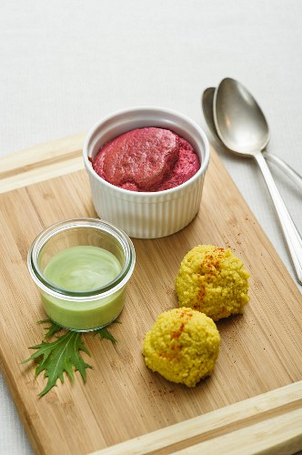 A baked beetroot soufflé with coriander sauce and couscous