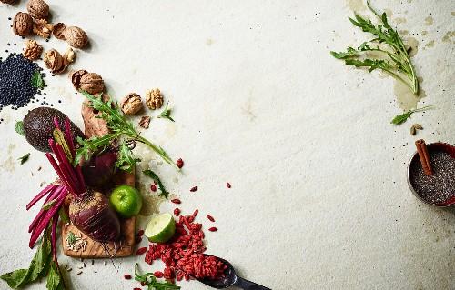 Various superfoods (goji berries, limes, beetroot, avocado, walnuts, chia seeds)