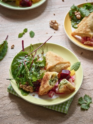 Austrian Schlutzkrapfen with a mixed leaf salad and colourful beet compote