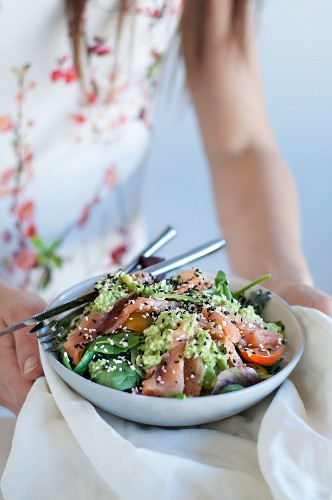 Avocado and salmon salad with sesame seeds
