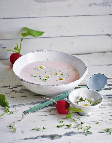 Pink radish soup with cress and wild flowers