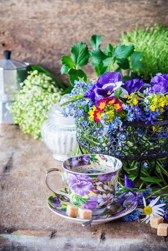 Cup of cofee with wild flowers