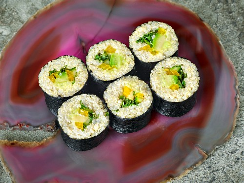 Vegetarian quinoa sushi with vegetables, fresh cheese and white miso paste
