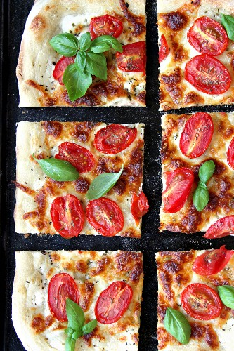Vegetarian pizza with tomatoes and fresh basil