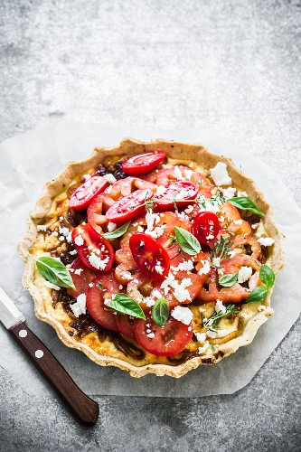 Caramelised onion tart with a fresh tomato salad