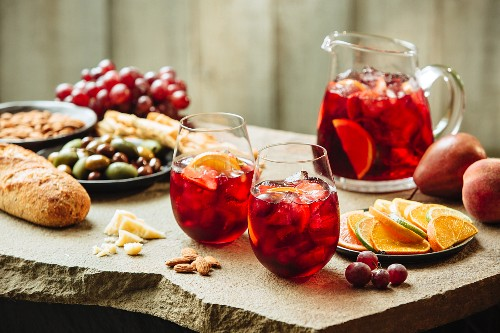 Sangria with fruit, olives and almonds