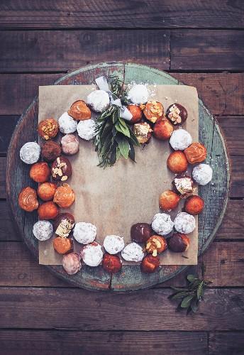 Doughnut balls with different glazes arranged in a wreath