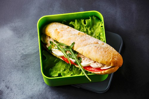 Take out food Sandwich with Tuna, egg and lettuce in Lunch box on blackboard background