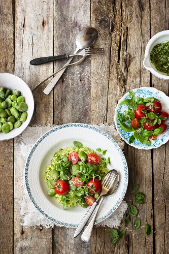 Risotto with broad bean, basil pesto, cherry tomatoes, parmesan, fresh basil and oregano