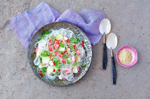 Soya bean pasta nad surimi salad with herbs