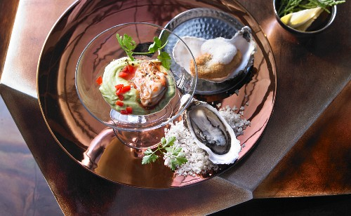 Oysters with rosé champagne foam and avocado cream