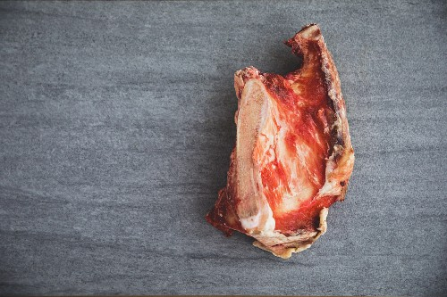 A raw organic meat bone (seen from above)