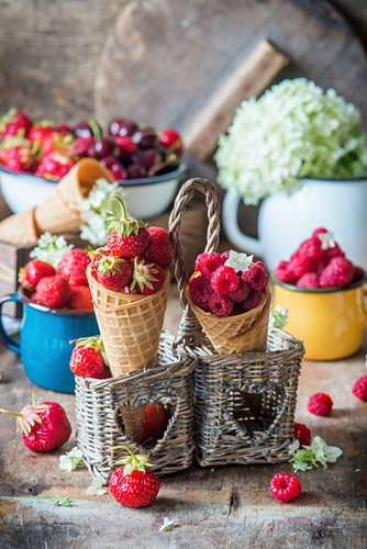 Strawberries and raspberries in ice cream cones