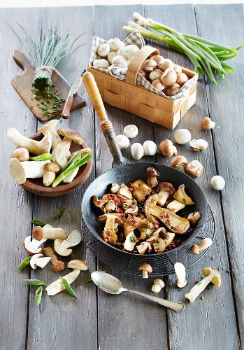 Mushrooms in a pan with spring onions and chives