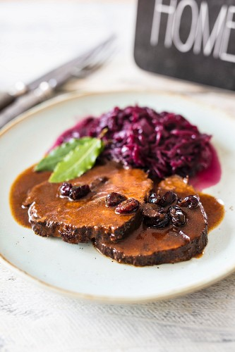 Sauerbraten (marinated pot roast) with cranberries and red cabbage