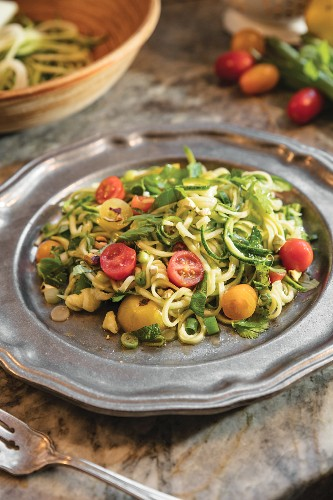 Zucchini Salad with Herbs and Pistachios on silver plate