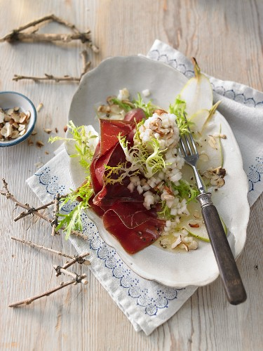 Bresaola with pear and nut tartar on rocket (Switzerland)