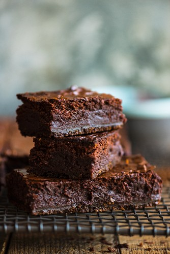 Stacked brownies on a cooling rack